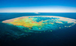 Bait Island on the Great Barrier Reef. The scope of efforts to save the world heritage site are unparalleled, an Australian government report says. Photograph: Justin Blank
