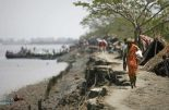 Rising sea levels caused by climate change will wipe out more cultivated land in Bangladesh than anywhere elsein the world,
